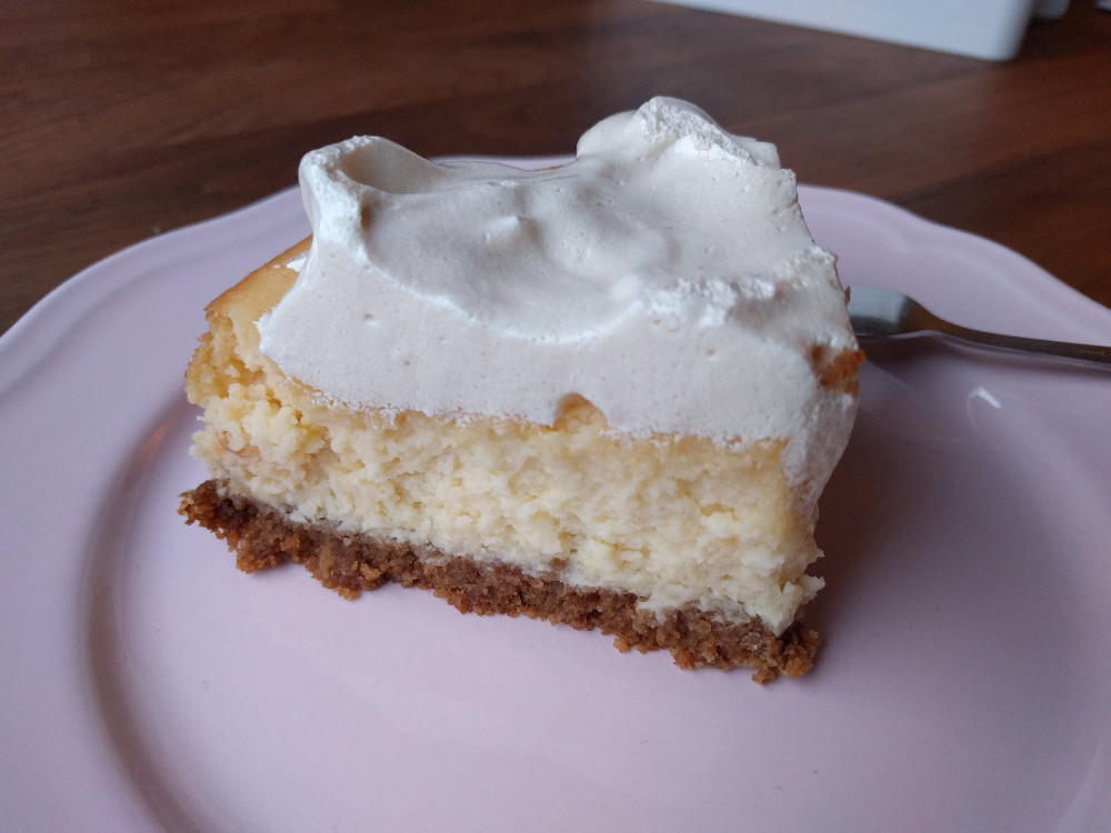 cheesecake with cookie crust and swiss meringue