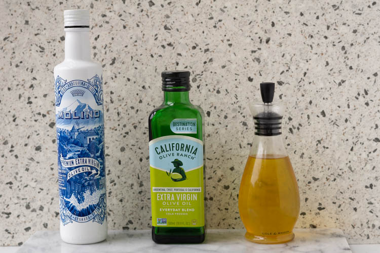 three different bottles with oil