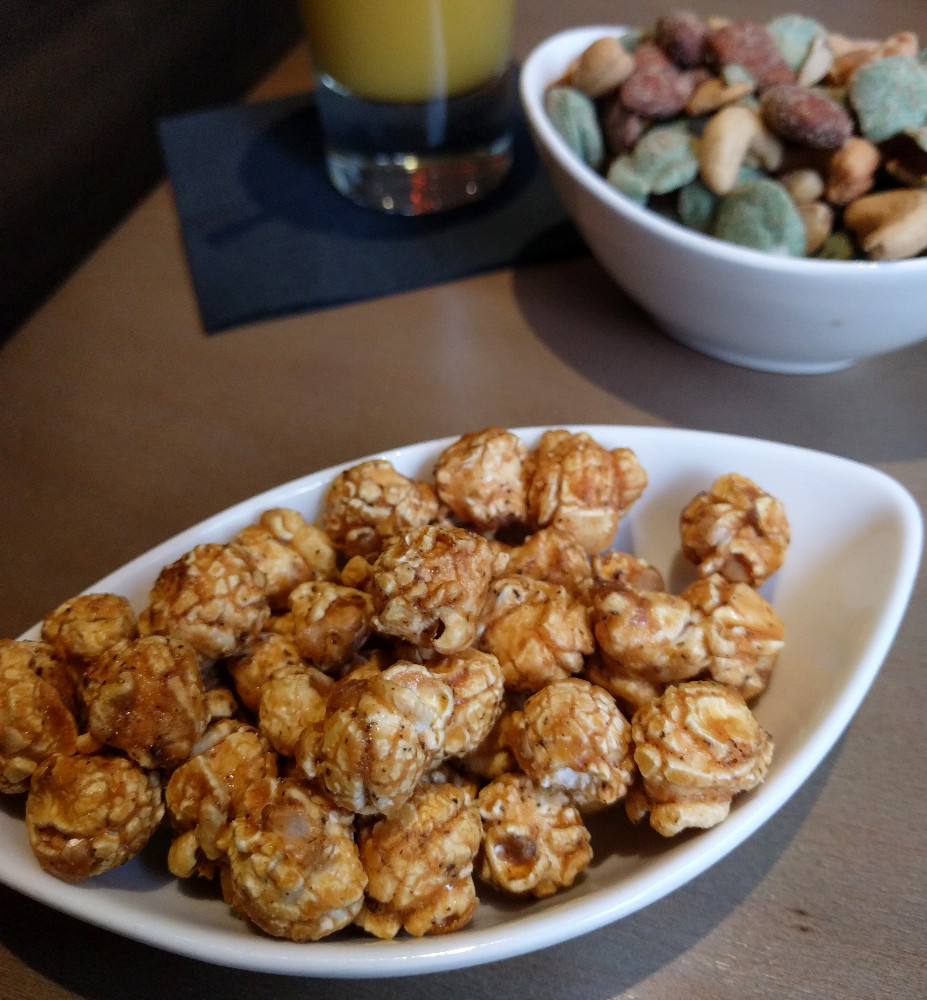 round popcorn, with caramel and black pepper