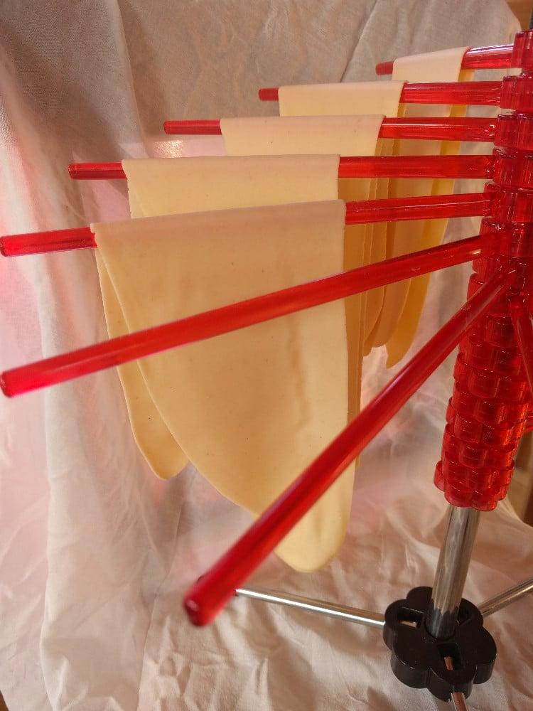 pasta drying on pasta rack