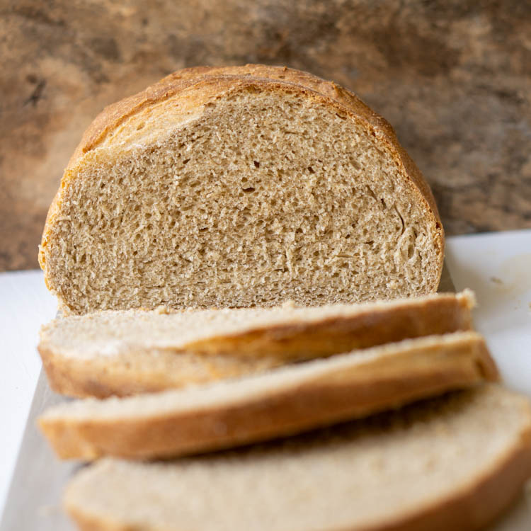 brown bread with few slices in front