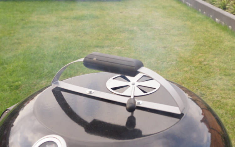 smoke coming out of the barbecue