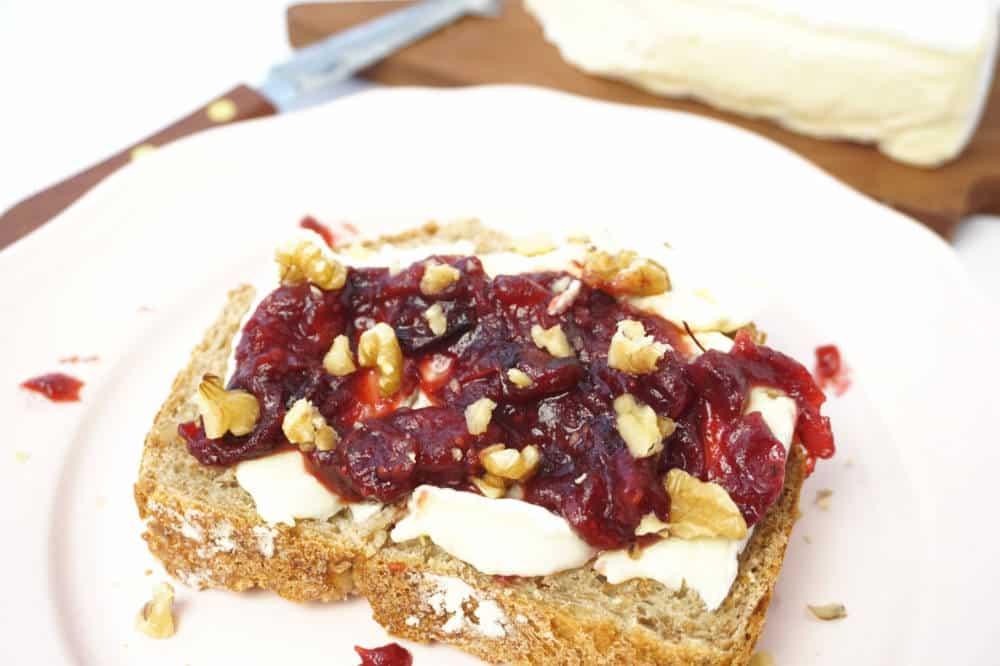 close up cranberry walnut brie sandwich