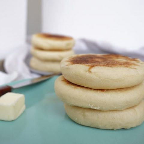 two stacks of freshly made English muffins