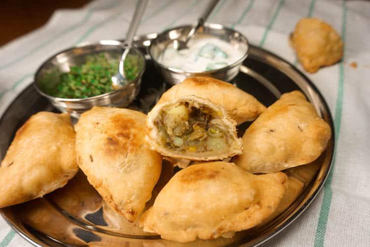 potato and green bean samosas with mint chutny and raita