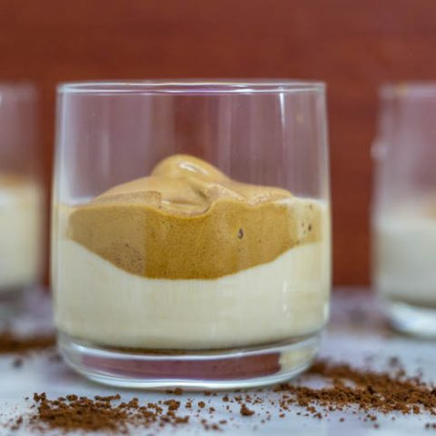 dalgona coffee with milk in glass