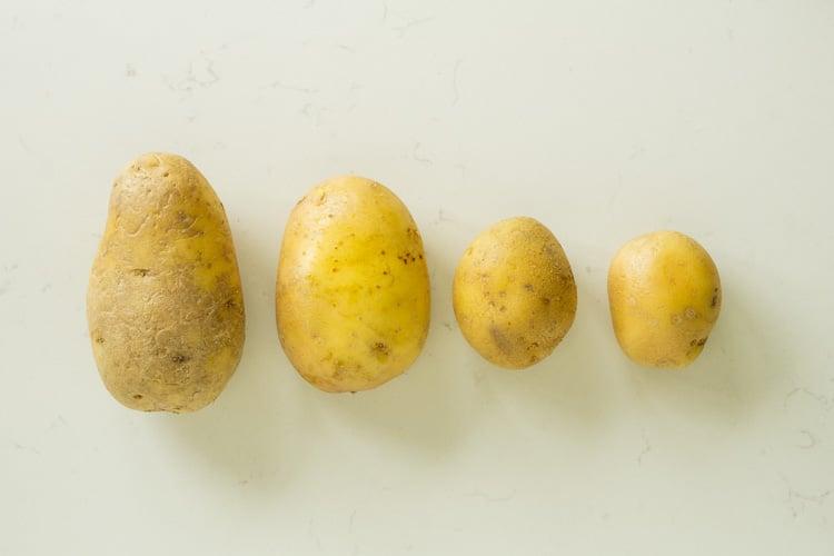 raw uncooked potatoes stored in fridge